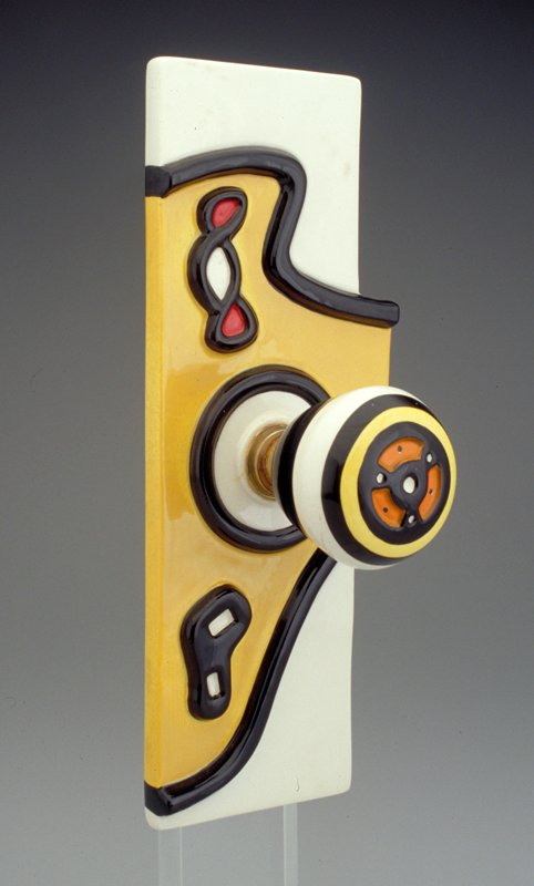 Yellow, white and black with orange and red; arrived with plexi stand