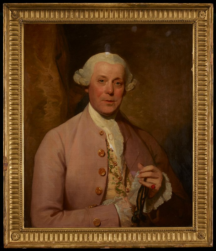 Portrait of Henry Lambert. Life size. Full faced, clean shaven, white perriwig, dove colored cloth coat with buttons at front and cuffs; white lace-edged neck cloth (with heart shaped gold stick pin), and wrist ruffles, rich cream colored and embroidered satin waistcoat; right hand is concealed by left, on little finger of which is a carnelian ring; around third finger of this hand is twisted some black velvet ribbon(?); background of soft mustard color, with drapery effect at left.