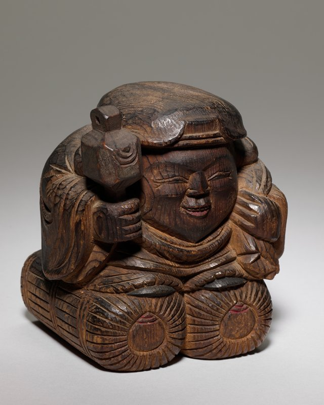 one of a pair of auspicious folk art figures: Daikoku and Ebisu; man with hammer and sack