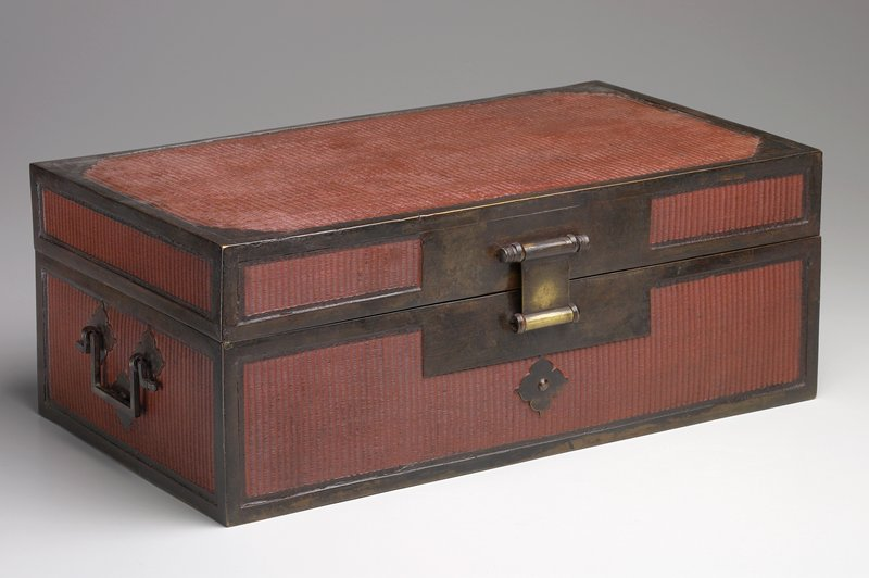 small chest with hinged lid; wood, covered with light brown woven bamboo, reinforced with metal edges; 2 elaborate handles on short sides; red wax seal on interior of cover