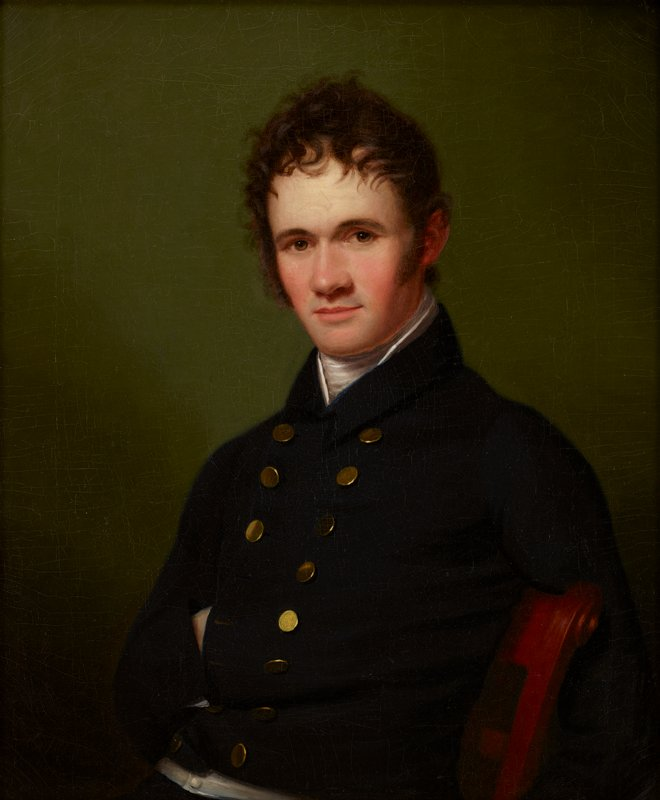 Portrait of a man, waist-length, seated.