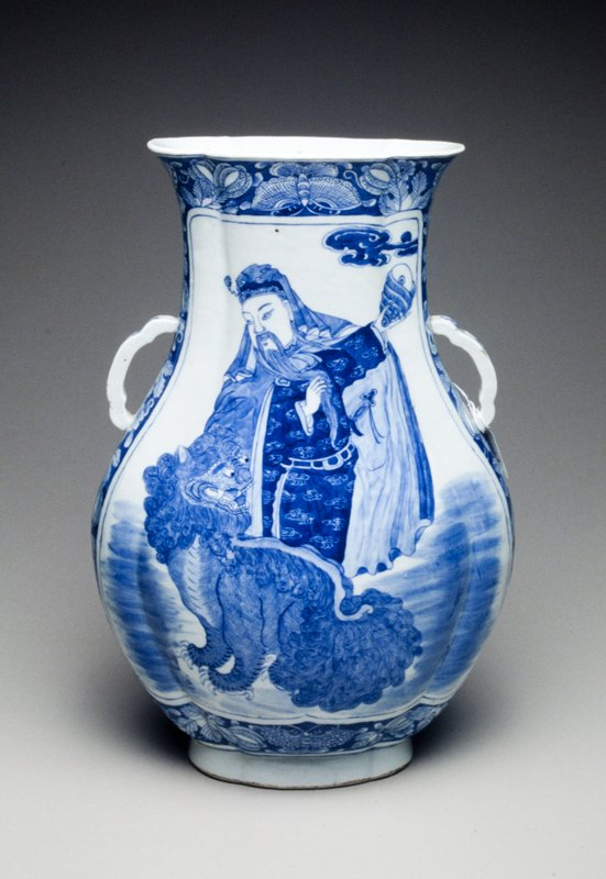 flattened oviform with lug handles; royal personage and Buddhistic lion motif in underglaze blue