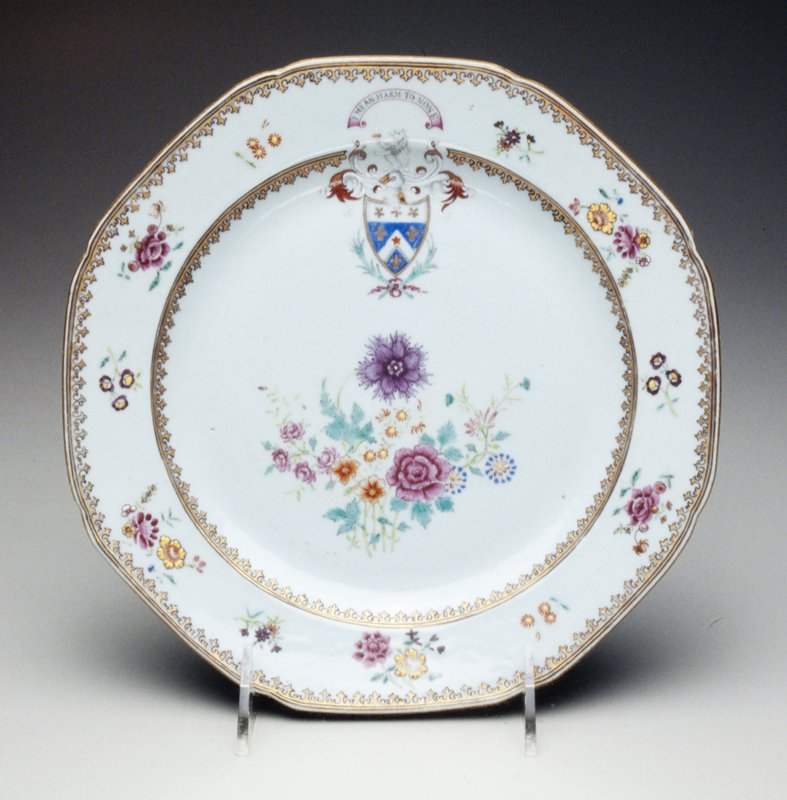 armorial dinner plate gray glaze floral center, border with flower sprigs, gilt rim, coat of arms and motto 'I Mean Harm to None'