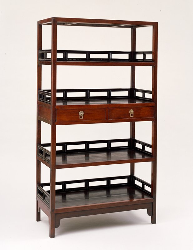 upright rectangular shape with five shelves; center shelf has two drawers below; square drawer pulls mounted to chrysanthemum back plates