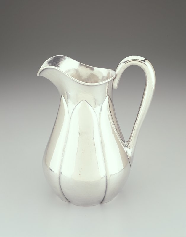 hand wrought silver pitcher with arched design