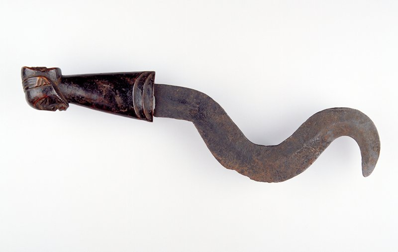 S-shaped blade, wood handle carved with human head