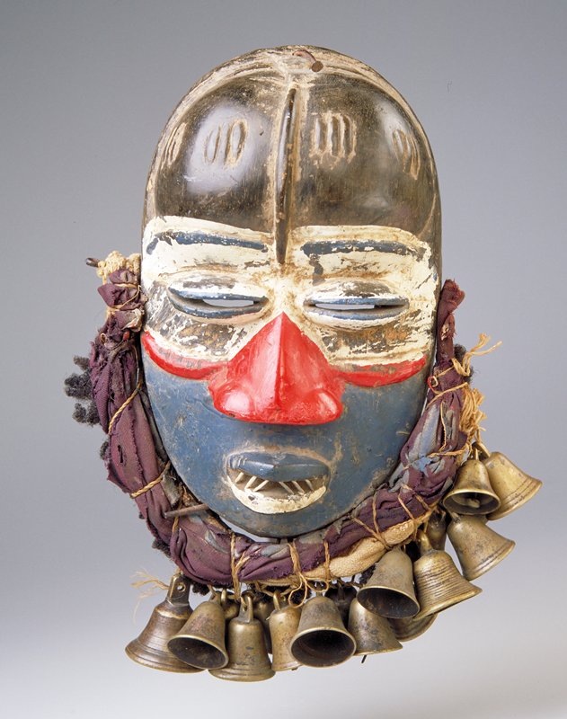 Wood mask with protruding eyes and ridge down center of forehead; painted white upper, red nose and cheeks with blue lower; cloth wrapped about lower half imitating a beard with single row of seventeen bells attached along bottom edge