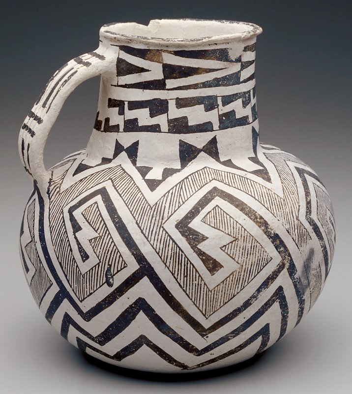 black and white geometric patterning overall; one handle