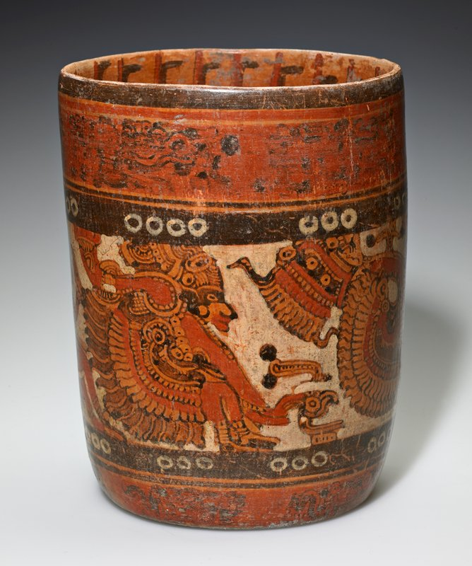 Vessel with figure band painted around the outside and interior is painted as well. Red, brown and orange throughout.