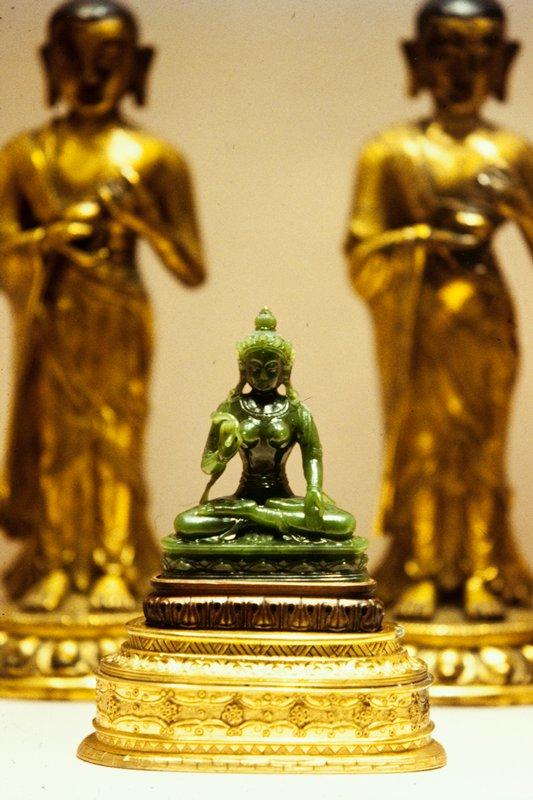 Bodhisattva of green jade. Gilt metal stand.