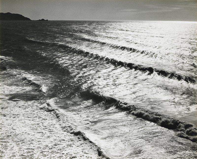4 gently breaking waves; large rocks in ULC