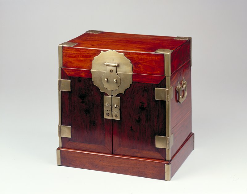 huang hua-li chest; lift lid top, double door front, seven drawer interior behind doors; metal handles, pulls, corner elements and large latch plate