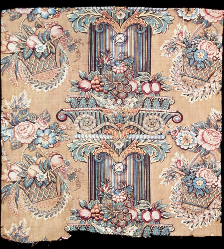 Toile, fragment of polychrome print in a large scale design of a column decorated with urns filled with flowers and flanked with a row of flower baskets and floral sprays. Blue, yellow, pink, green and yellow on cocoa-colored ground.