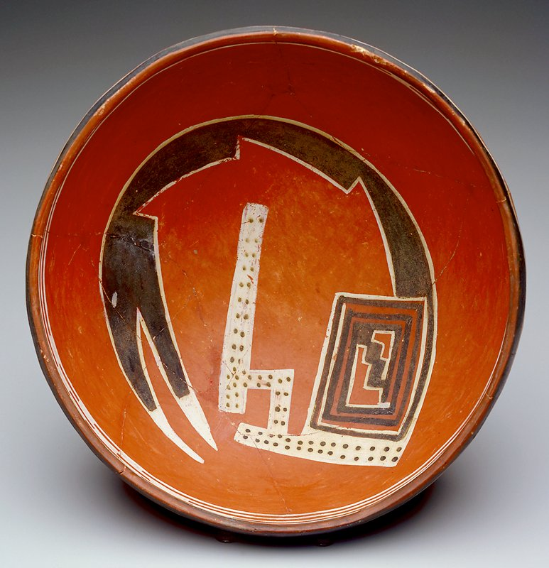 Round-bottomed bowl; red with serpent/bird in brown and white at interior; brown rim with white linear design on interior and white zigzag flanked by brown stripes on exterior