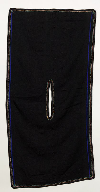 "black woven poncho with 1/2"" wide blue woven stripe on each side; finished on 4 sides with red and green cotton thread, zigzag machine stitched; green and yellow cotton curly machine sewn selvedge around edges; weave has vertical 11"" long button hole in central part for head; square design on edge"