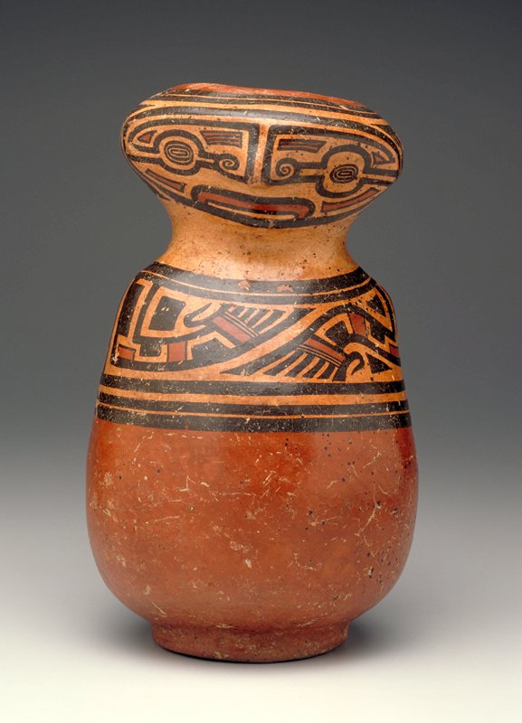body of vessel shaped like abstracted figure with bulges at shoulders and spine and flat face; stylized geometric facial features and arms in rust, brown and tan