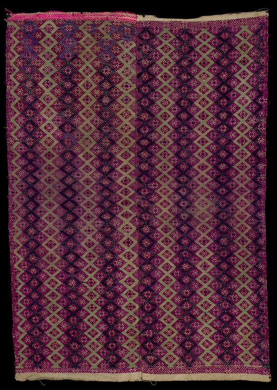 two panels sewn together; dark and light purple with green and small border of hot pink on off-white; repeating diamonds with stars