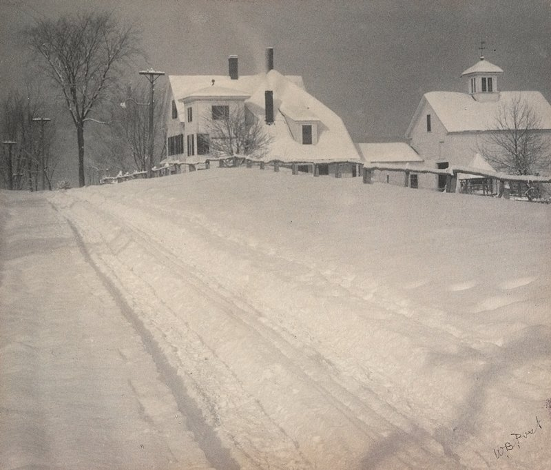 large house and barn covered in snow; tracks from LLC; bare trees and telephone poles in ULC