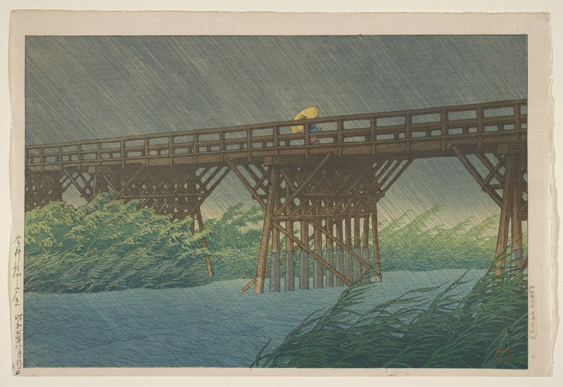landscape; figure with yellow umbrella on a bridge at center; slanted falling rain; grass and foliage bent from wind and rain; grey sky