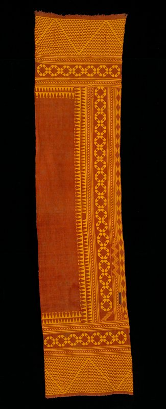 Embroidered with red, black, greens, orange, pink around central panel Ikat (later addition); black border with machine stitching; lining is ecru and red floral printed fabric.