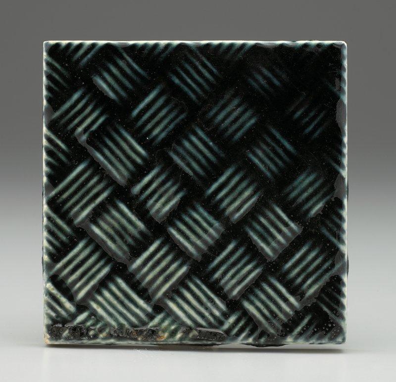 basketweave design with dark blue-green glaze