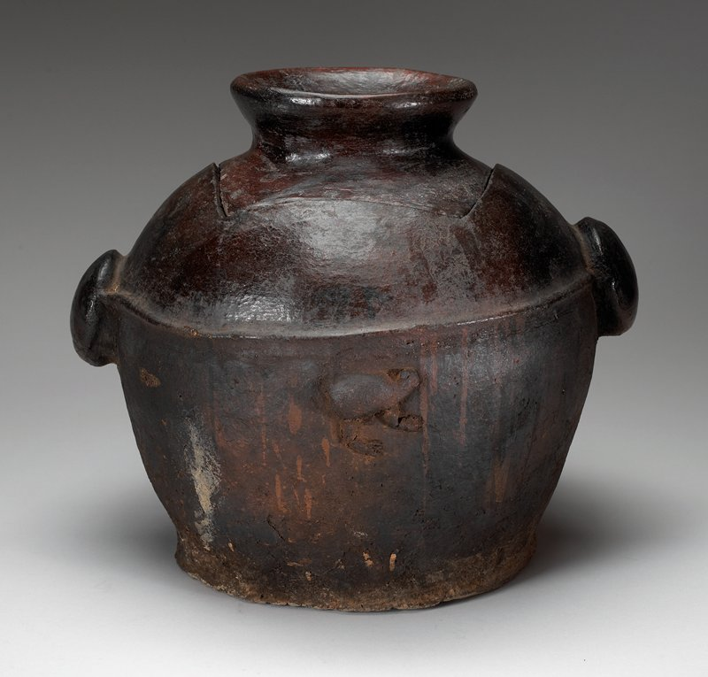 thick, flat base; rounded body; pair of thick, round, domed handles; square opening for cover with bowl-like finial; body decorated with three applied animals