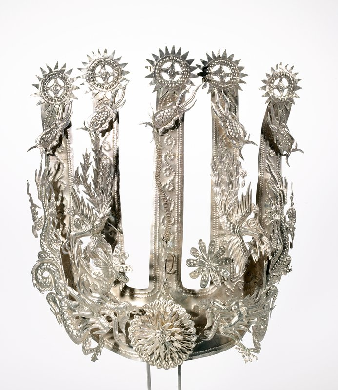 headdress attached to two picks; five radiating elements extending upward with applied cut-out dragons, birds and flowers; hammered scrolling design on radiating elements