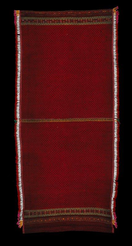 Red and black stripes and diamonds; fringe of ceramic beads. Tubular skirt.
