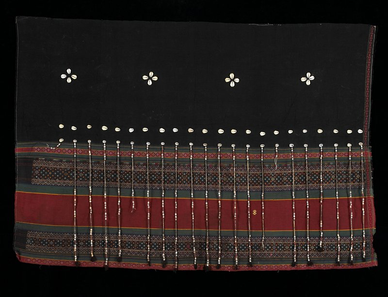 Two panels sewn together, top is plain black with four groups of shells and two torizontal rows; bottom green, burgundy stripes alternating with diamond pattern section.