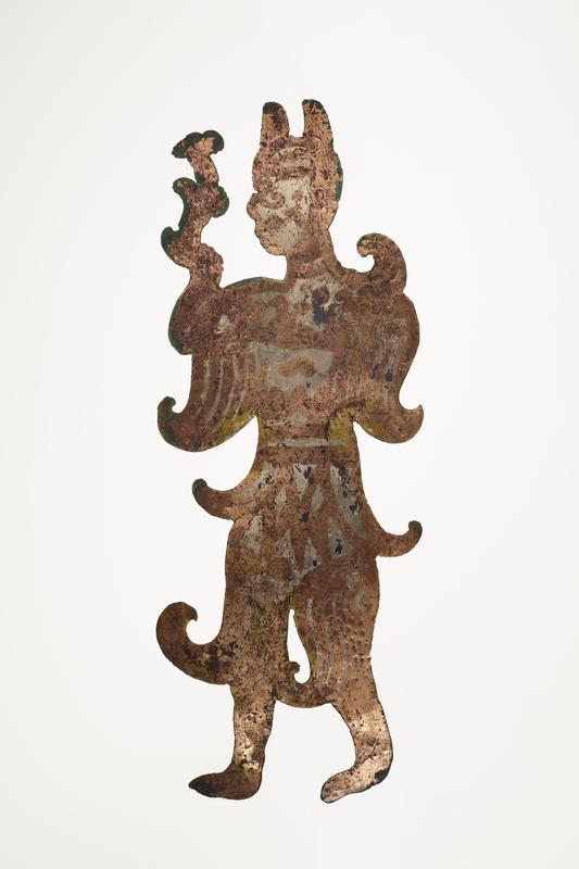 standing figure holding a flower-like object; facing L; incised details; mounted on black cloth-covered board with L2003.116.10.1