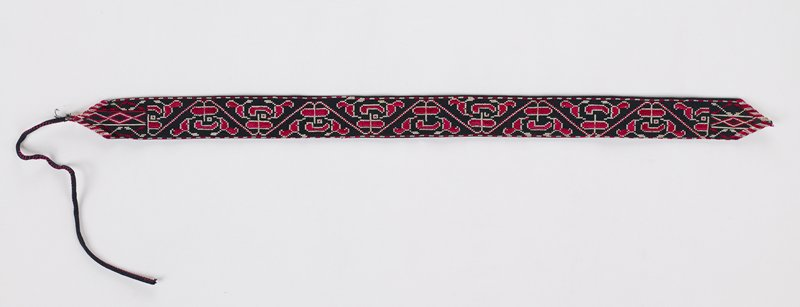 black background; dark pink and white geometric and organic designs embroidered