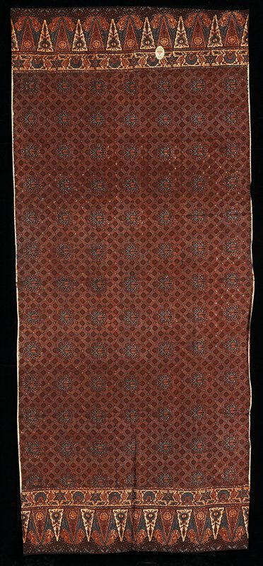 brown and blue on cream; floral medallions over squares with floral designs; border of organic and leaf-like designs at hemmed edges