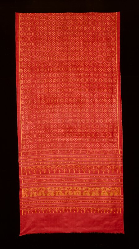 red and gold ikat; red field, gold detailing; large central diamond pattern, thirteen bands of ikat at each end before plain field and short fringe