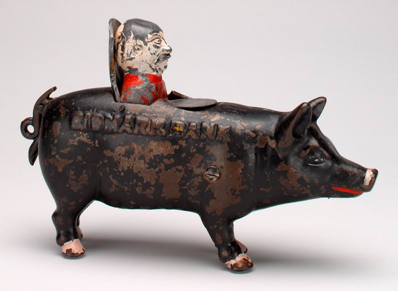 giant black pig with red lips and pink nose; Otto von Bismarck emerges from pig's back