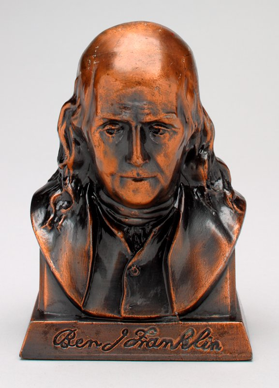 bust of Franklin; copper color; coin slot in back