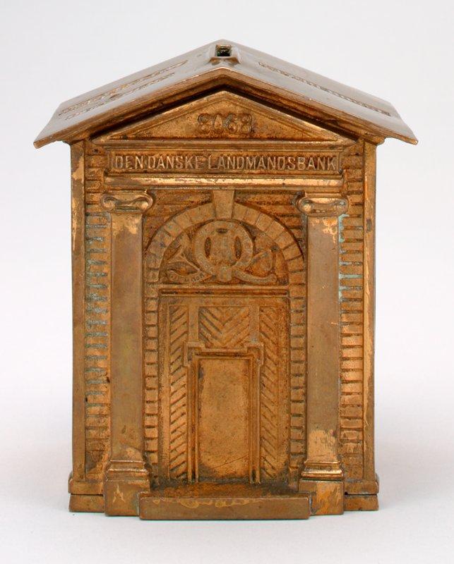 """building-shaped bank; engaged flat columns; """"8068"""" and """"Den Danske Landmandsbank"""" above door; gold finish"""