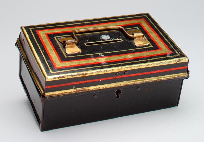 rectangular box with hinged cover; black with gold and red details on cover; handle on cover