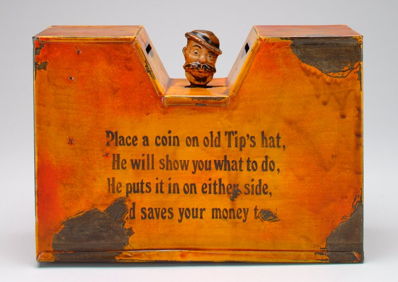 rectangular shape with wedge cutout at top center; head of mustached man wearing hat in wedge; poem on front and back; pennies on short sides; orange-yellow body