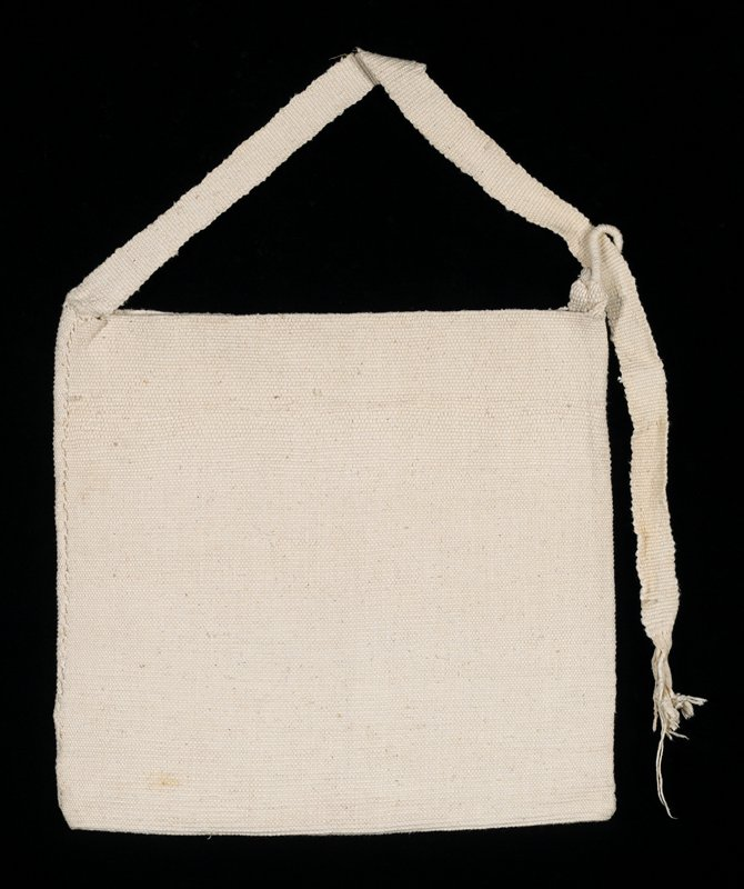White knitted bag with strap.
