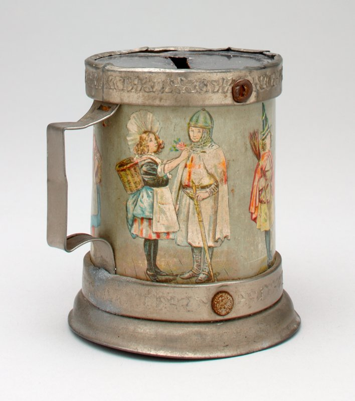 silver colored mug-shaped bank with an inset of cardboard covered with colored images of costumed girls and boys (4 pairs)