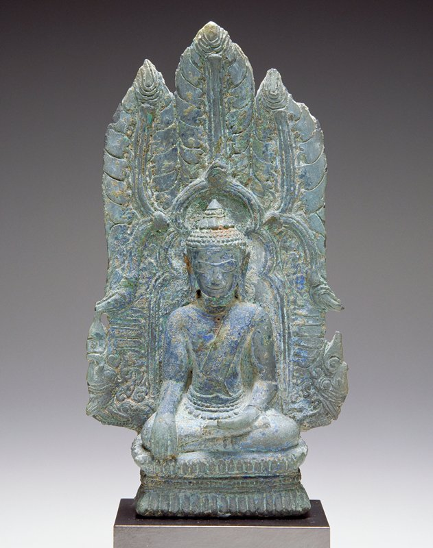 seated Buddha with PL hand palm up on lap and PR hand on knee; organic, leaflike designs on back of throne; attached to mount