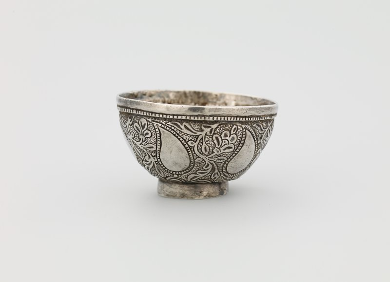very small bowl shape on ring foot; hammered organic paisley-like design