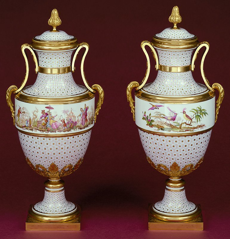 covered vase, cat. card does not list 'a-b' for vase and lid; white ground, painted with turquoise and gold circle-and-dot pattern (oeil-de-perdrix); the wide decorative bands are adorned with exotic birds and chinoisirie. The subjects and decorative grounds link them to a pair in the collection of Queen Elizabeth thought to have been bought by Marie Antoinette in 1779. The similar oeil-de-perdix of both pairs may be attributed to Vincent Taillandier, who specialized in this type of patterned ground