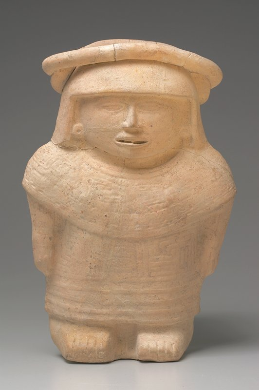 standing female figure, mold made with incised linear designs, cream colored earthenware