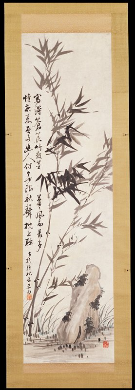 two long slender stalks of bamboo grow from the left corner; left of bamboo is a lichen-covered rock; two lines of Chinese running script extend down left side