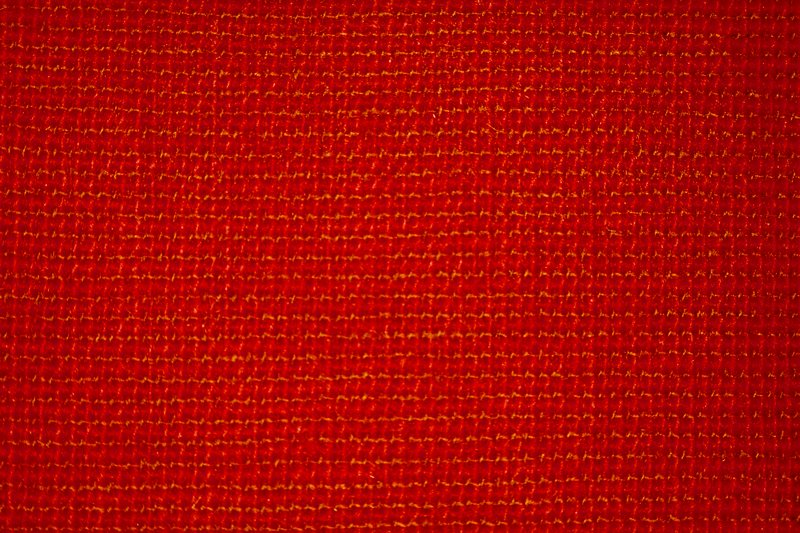 Hand woven plain weave. Weft threads of natural and dark tan alternating. Warp is same. Hand woven plain weave. Weft and warp threads of red and rust alternate. Backed with acrylic latex, moth-proofed. Brambleberry