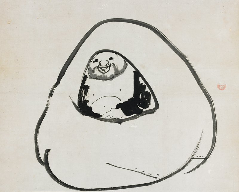 heavy-set man seated inside a large sack; smiling man has light beard and wears dark garment, open at the chest; has storage box