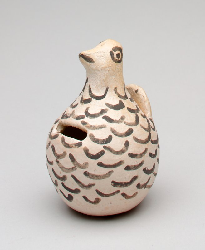 small ceramic white bird with upright tail and black painted feather outlines, eyes and beak; mark in pencil on bottom