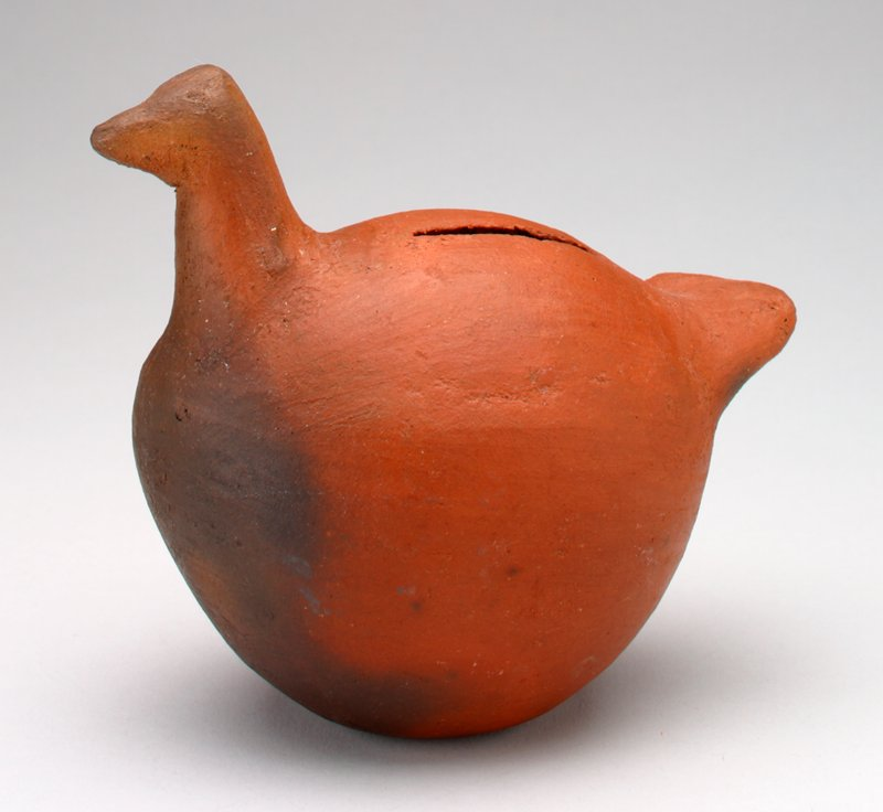 red-brown, clay, bird shape with small head, short tail and round body; coin slot in back;