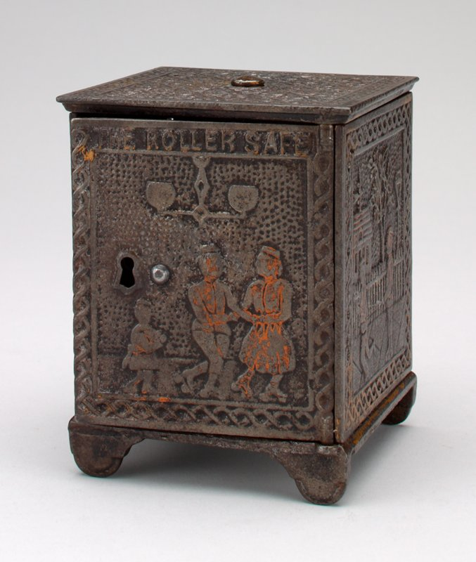 brown block-shaped bank with figures on side panels in roller skates; coin slot in side opposite door top edge